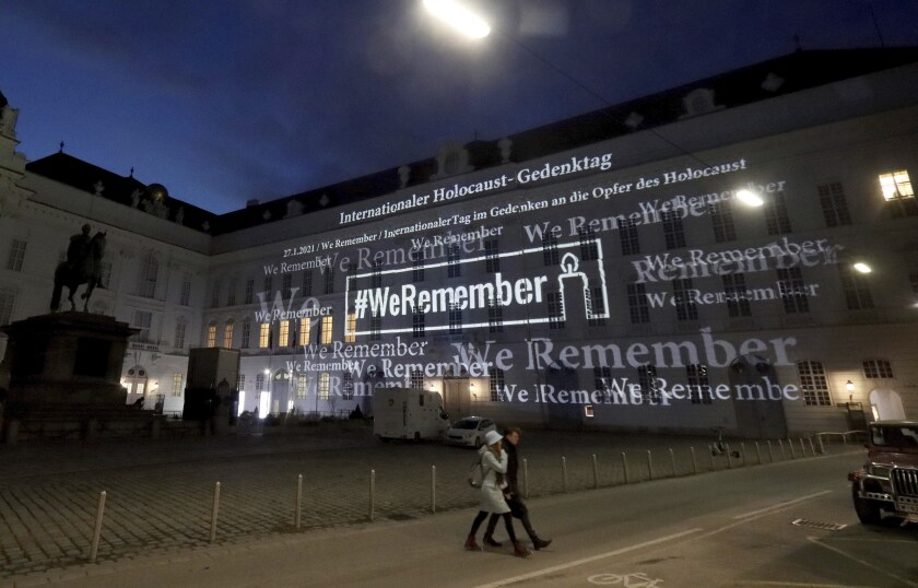 """The words """"#WeRemember"""" are displayed on the Austrian Parliament building on Jan. 27."""