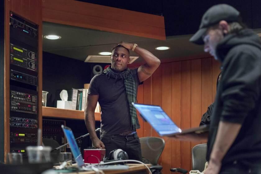 LOS ANGELES, CALIFORNIA - MAR. 1, 2019: (C) British actor Idris Elba talks with (R) Sonny John Moore