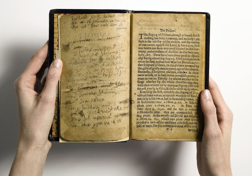 """This file photo provided by Sotheby's and taken in New York shows what the auction house describes as """"the world's most valuable book,"""" the Bay Psalm Book."""
