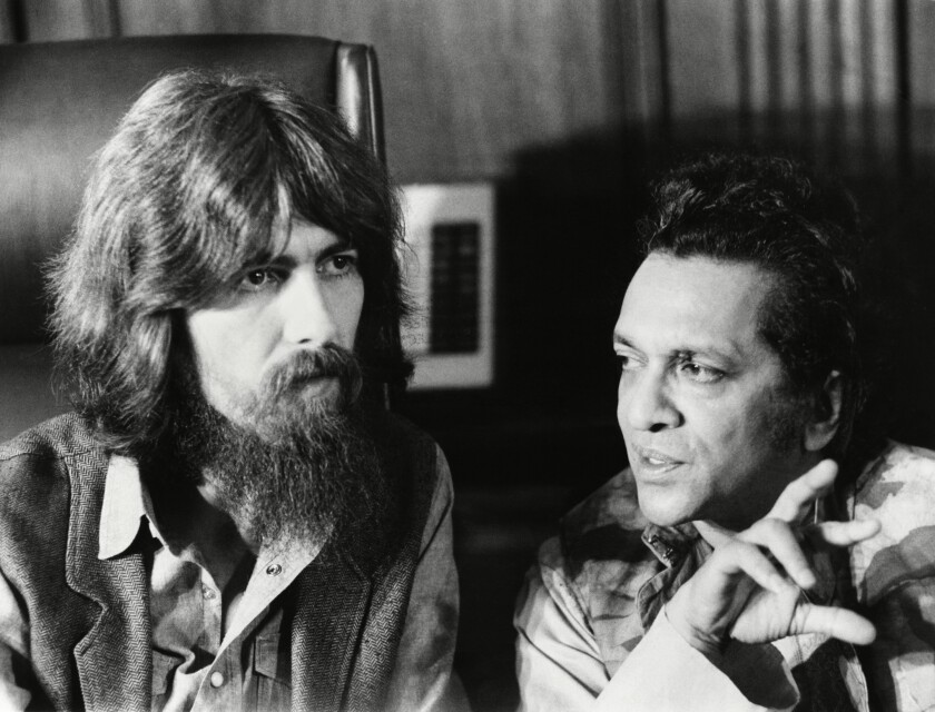 """George Harrison and Ravi Shankar are shown talking to each other in the documentary series """"1971."""""""