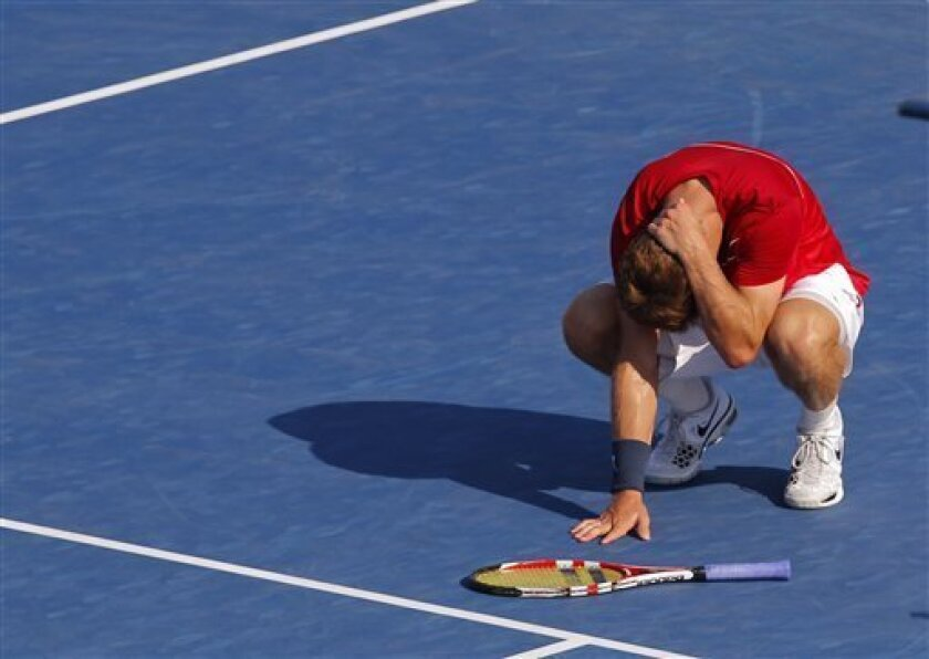 Ryan Harrison reacts during his match against Argentina's Juan Martin Del Potro in the third round of play at the 2012 US Open tennis tournament,  Friday, Aug. 31, 2012, in New York. Harrison lost the match. (AP Photo/Paul Bereswill)