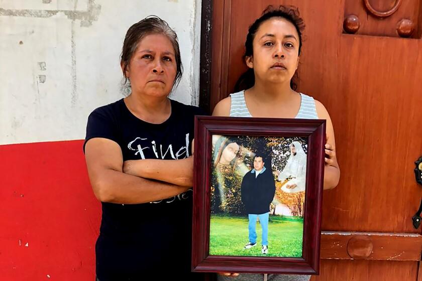Maclovia Zacatenco and daughter Saida Rojas outside home in La Magdalena Axocopan, Mexico