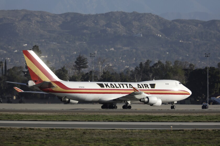 A Boeing 747 on a charter flight from Wuhan, China, arrives Wednesday at March Air Reserve Base in Riverside County.