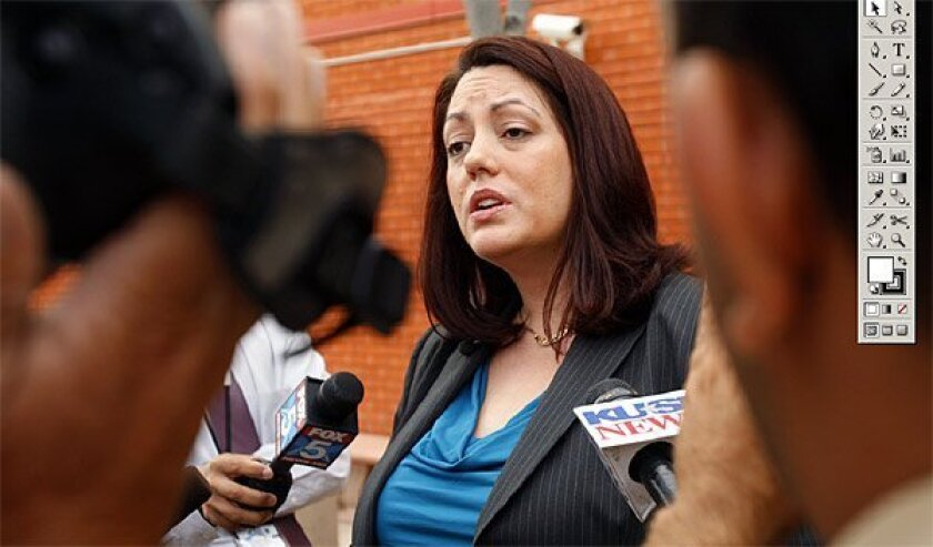 Prosecutor Aimee McLeod spoke outside court yesterday after a high school student was charged with vehicular manslaughter and drunken driving. (K.C. Alfred / Union-Tribune)