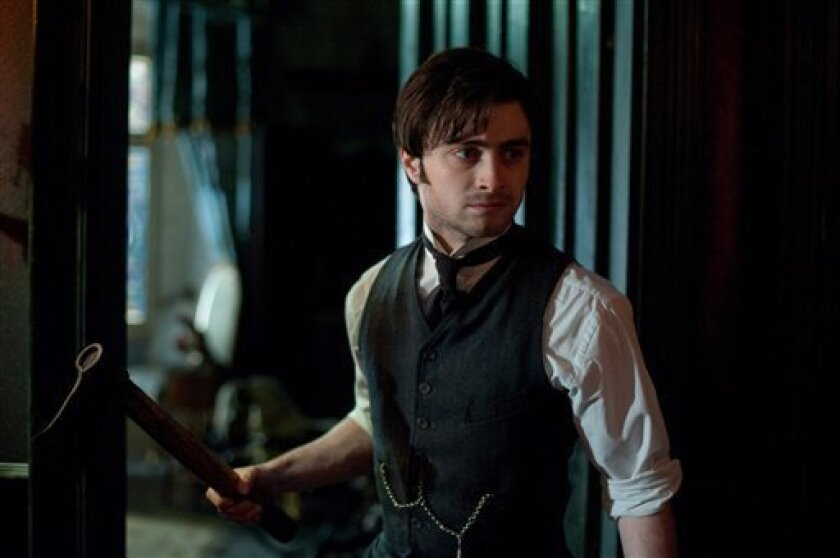 """In this film image released by CBS Films, Daniel Radcliffe is shown in a scene from the supernatural thriller """"The Woman in Black."""" (AP Photo/CBS Films, Nick Wall)"""