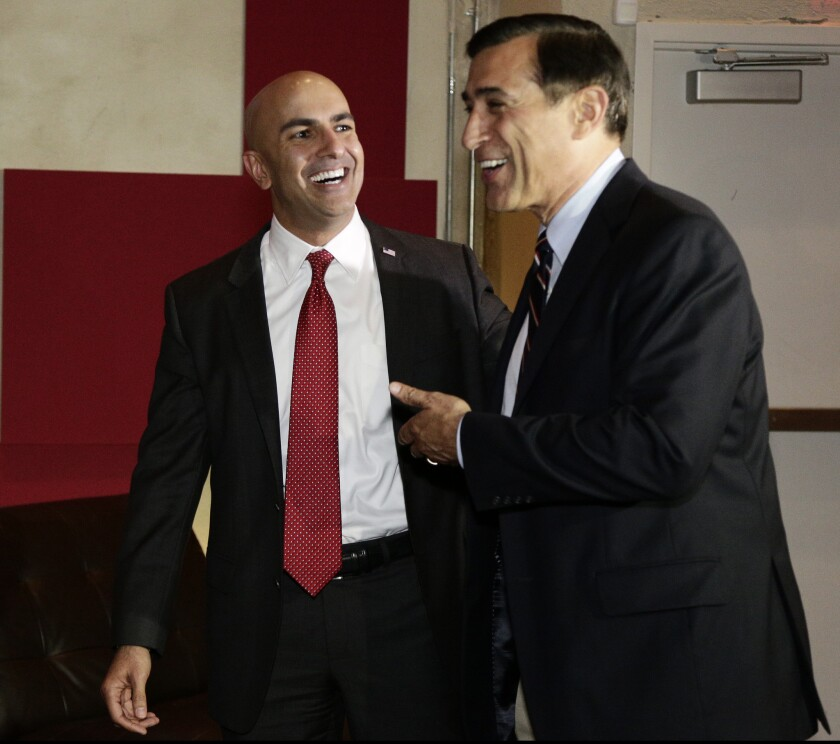 Gubernatorial candidate Neel Kashkari gets the support of U.S. Rep. Darrell Issa at Kashkari's election night party in Corona del Mar.