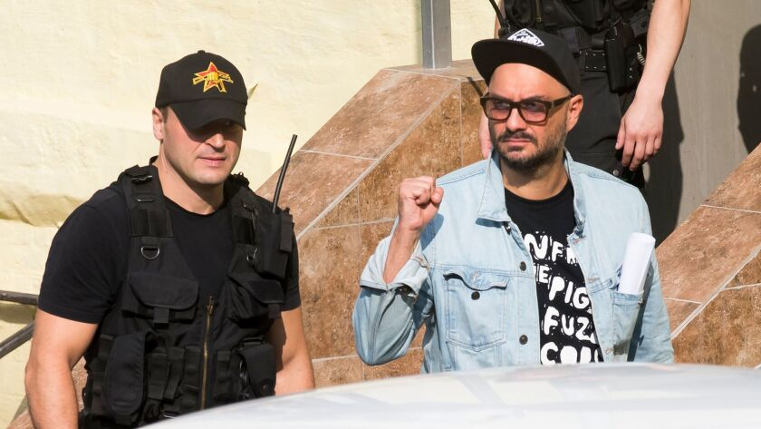 Russian theater and film director Kirill Serebrennikov, right, acknowledges supporters as he leaves court in Moscow.