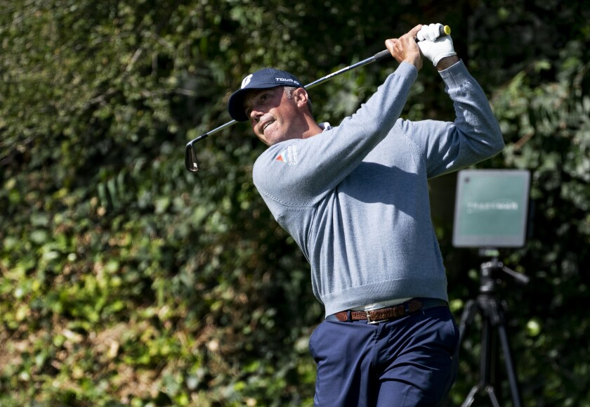 Matt Kuchar hits his tee shot on the sixth hole during the first round of the Genesis Invitational at Riviera Country Club.