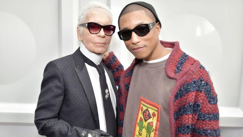 Karl Lagerfeld, left, and Pharrell Williams