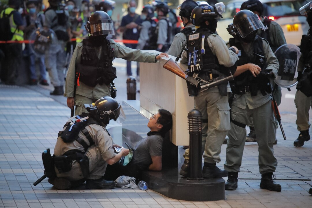 Hong Kong police detain a security law protester on Wednesday.