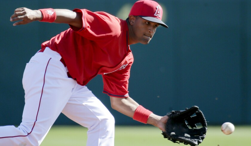 Angels infielder Roberto Baldoquin fields a ball during batting practice on in Tempe, Ariz.