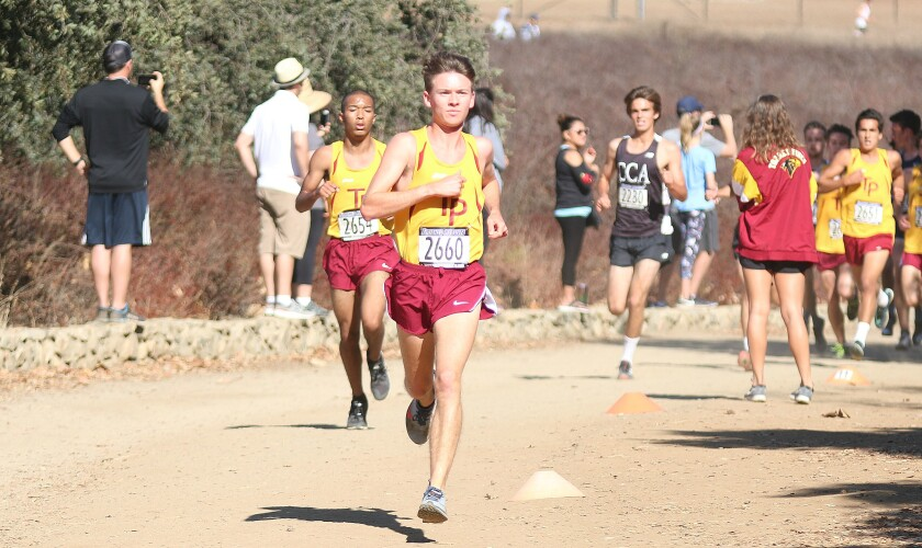 Second place finisher Nick Salz of Torrey Pines comes through the two-mile marker.