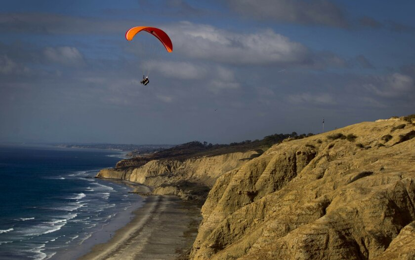 Paragliders take advantage of the breezy weather at the Torrey Pines Gliderport as cooler weather makes its way to the county.
