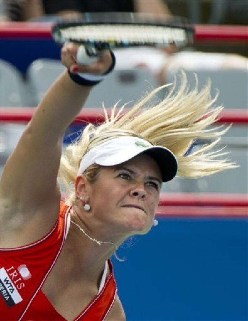 Canada's Aleksandra Wozniak serves to Christina McHale from the United States during third round play at the Rogers Cup tennis tournament in Montreal, Saturday, August 11, 2012. Wozniak won 7-6(5), 6-3 to move on to the quarter-finals. (AP Photo/The Canadian Press, Paul Chiasson)