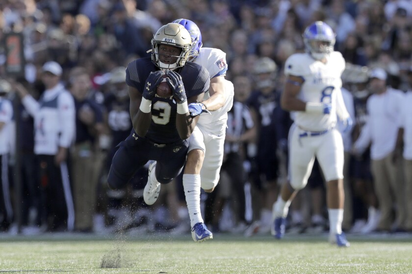 Navy wide receiver Mychal Cooper, front, makes a catch as Air Force defensive back Milton Bugg III defends during the first half of an NCAA college football game Saturday, Oct. 5, 2019, in Annapolis, Md. (AP Photo/Julio Cortez)