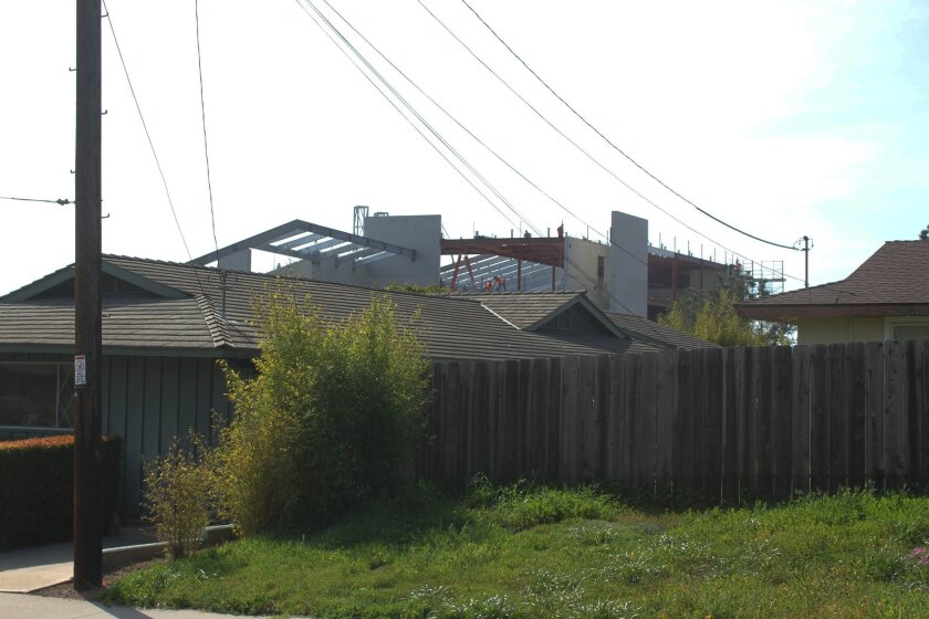 The frame of the J. Craig Venter Institute off Torrey Pines Road rises above this residential neighborhood near UC San Diego. the 45,000-square foot genetic research laboratory is scheduled to open later this year. Pat Sherman