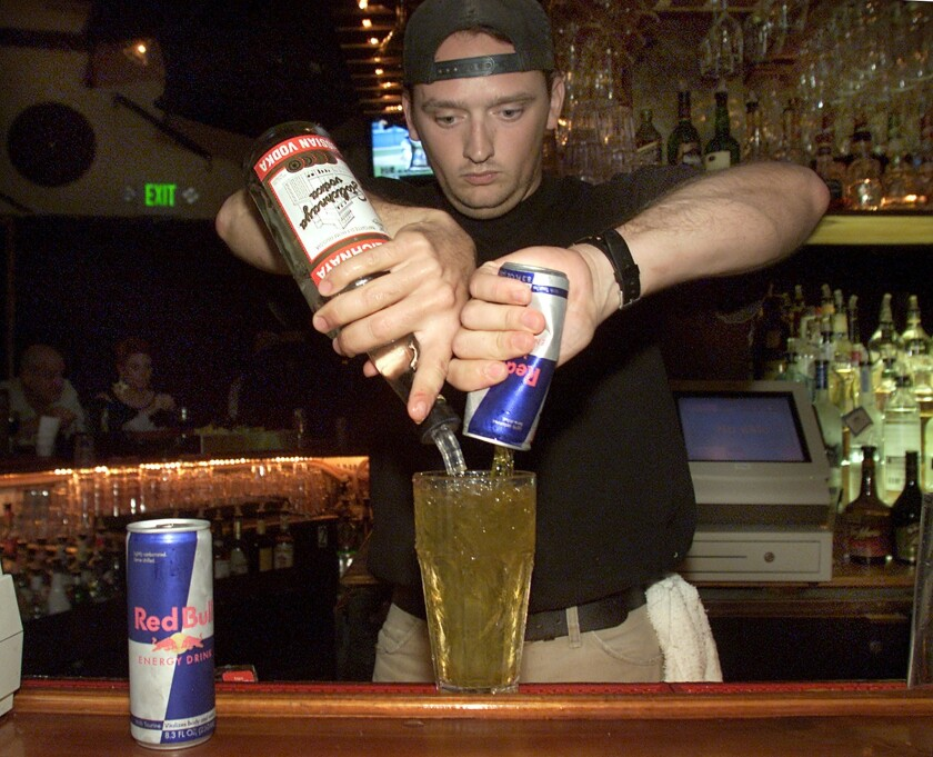Bartender Tom Gordon pours a Red Bull and vodka mixed drink at Saddle Ranch restaurant in West Hollywood. A new study suggests drinking alcohol mixed with an energy drink may cause some to want to drink more alcohol.