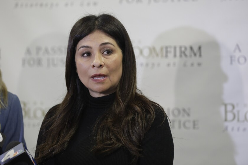 WOODLAND HILLS, CA - March 6, 2019: LAPD Detective Ysabel Villegas attends a news conference with he