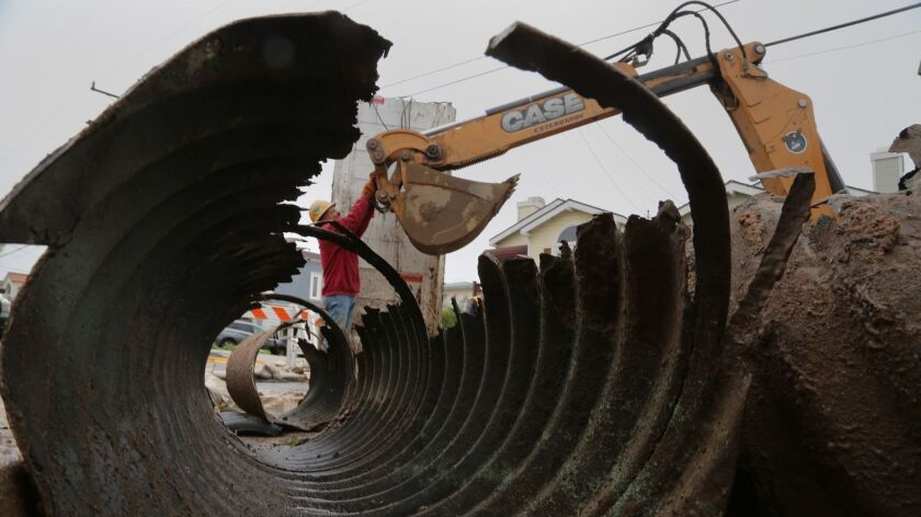 Crews from Redondo Beach Public Works repair and replace a section of damaged and deteriorated storm drain pipe on Ford Avenue.