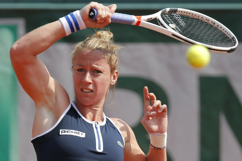 France's Pauline Parmentier returns the ball to Timea Bacsinszky of Switzerland during their third round match of the French Open tennis tournament at the Roland Garros stadium, Saturday, May 28, 2016 in Paris.  (AP Photo/Christophe Ena)