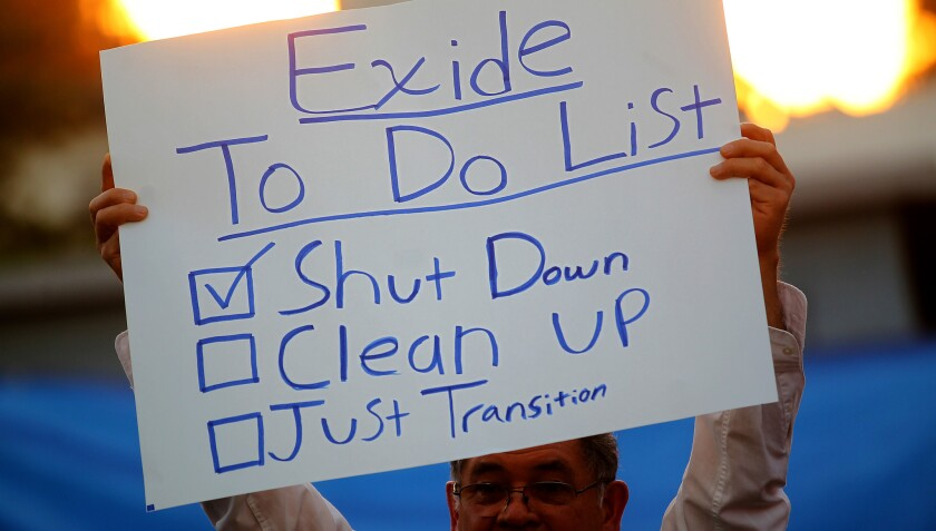 Community members and activists gather in a backyard of a home east of downtown Los Angeles to mark the closure of the Exide Tchnologies battery recycling plant on Thursday, Mar. 12, 2015.