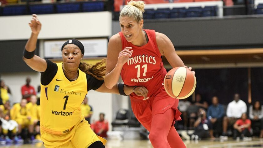 Washington Mystics guard Elena Delle Donne (11) drives to the basket as Los Angeles Sparks guard Ody