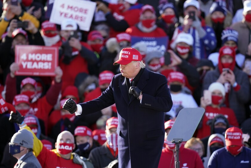 President Trump finishes a campaign rally Sunday in Dubuque, Iowa.