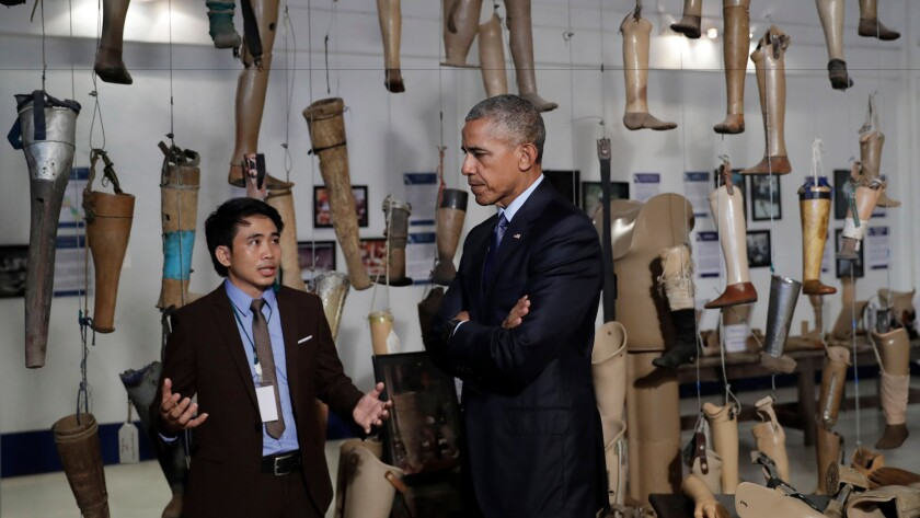 President Obama tours the Cooperative Orthotic and Prosthetic Enterprise center in Vientiane, Laos, on Wednesday.