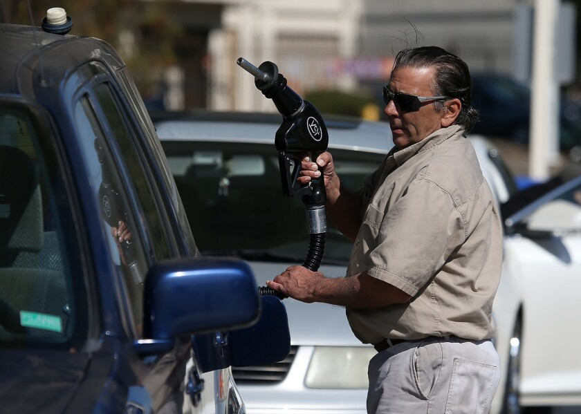 A customer prepares to pump gasoline into his car at an Arco gas station on March 3, 2015, in Mill Valley, Calif.