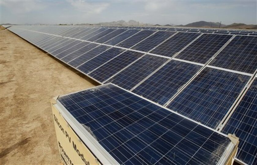 Desert solar projects continue to be built. This photo from 2012 shows an array in Arlington, Ariz. NRG Solar recently secured a bank loan to build a solar park on 40 acres at SDSU's Imperial County campus. AP Photo