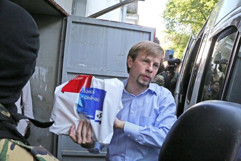Yaroslavl Mayor Yevgeny Urlashov is escorted by police Wednesday.