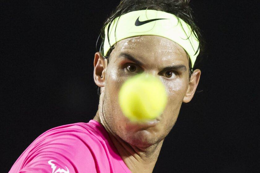Rafael Nadal, of Spain, eyes a ball at the quarter-finals match of the Rio Open tennis tournament against Pablo Cuevas of Uruguay in Rio de Janeiro, Brazil, early Saturday, Feb. 21, 2015. (AP Photo/Felipe Dana)