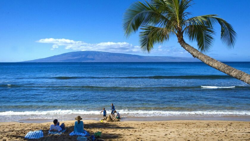 Beachgoers enjoy the sand and waters of Kaanapali Beach on Maui in Hawaii. Maui will be one of two destinations for Southwest Airlines' new nonstop flights between San Diego and Hawaii, debuting in April.