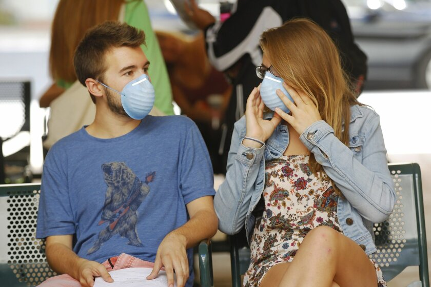 Travis Johnson and Katelyn Markham waited to get antibiotics at San Diego State University's health center on Oct. 17, 2014 after fellow student Sara Stelzer became infected with meningitis B and died. / photo by K.C. Alfred * U-T