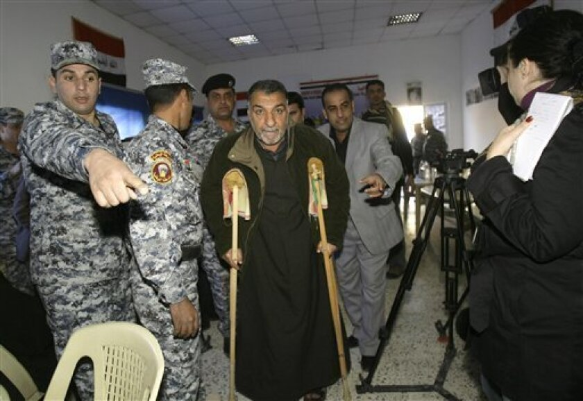 Adil Jabr, 55, center, arrives for a meeting with a U.S. prosecutors to discuss the case against the Blackwater Worldwide guards indicted in the fatal September 2007 shooting in the Baghdad's Nisoor Square, in Baghdad, Saturday, Dec. 13, 2008. Five Blackwater guards were indicted this week on manslaughter and other charges for their alleged roles in the Sept. 16, 2007 shooting in Nisoor Square. A sixth guard reached a plea deal with prosecutors to avoid a mandatory 30-year prison sentence. (AP Photo/Khalid Mohammed)