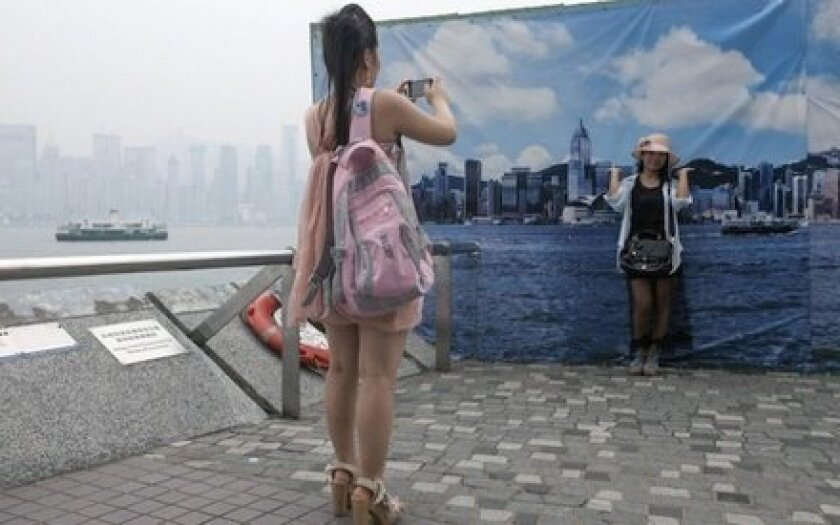 When it's hazy in Hong Kong, tourists can pose in front of an oversize photo of the skyline for a picture-perfect (if misleading) view.
