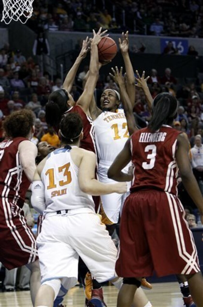 Tennessee's Bashaara Graves (12) shoots against Oklahoma in the second half of a regional semifinal game in the women's NCAA college basketball tournament in Oklahoma City, Sunday, March 31, 2013.  Tennessee won 74-59.  (AP Photo/Alonzo Adams)