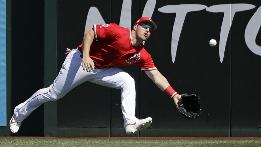 Angels center fielder Mike Trout can't come up with a double by Chicago Cubs catcher Willson Contreras in the first inning. Trout kicked the ball away and Contreras scored on the error.