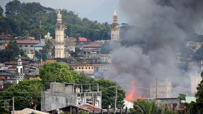 A fire rages after airstrikes by the Philippine air force in the southern city of Marawi.