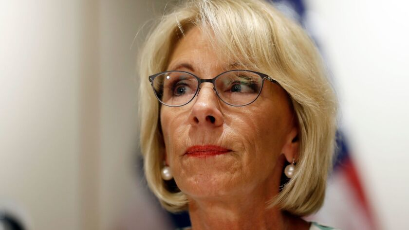 Education Secretary Betsy DeVos pauses while speaking with the media after a series of listening ses