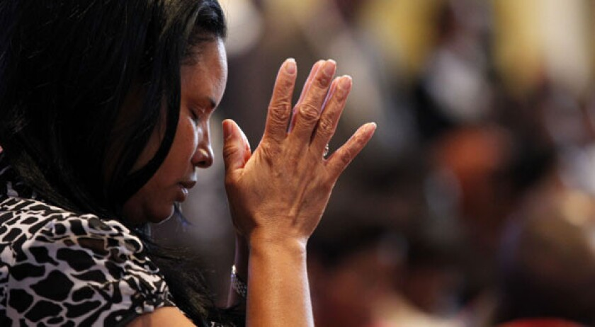 A worshiper at Franklin Avenue Baptist Church in New Orleans, whose pastor is the Rev. Fred Luter Jr., the first black president of the Southern Baptist Convention. A day after Luter was made president, the denomination took another step in its evolution by adopting an alternative name.