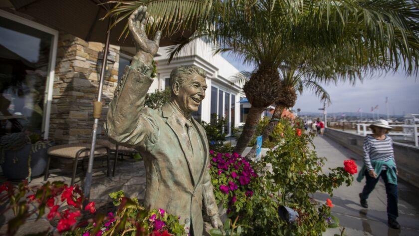 NEWPORT BEACH, CALIF. -- MONDAY, OCTOBER 29, 2018: A statue of President Ronald Reagan adorns a Balb