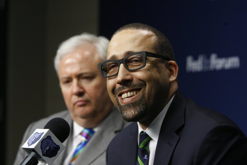 David Fizdale speaks at a news conference where he is introduced as the new head coach of the Memphis Grizzlies NBA basketball team Tuesday, May 31, 2016, in Memphis, Tenn. Fizdale was previously the assistant head coach of the Miami Heat. General manager Chris Wallace listens at left. (AP Photo/Ka