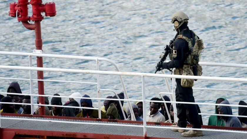 TOPSHOT-MALTA-EUROPE-MIGRANTS-LIBYA-HIJACK