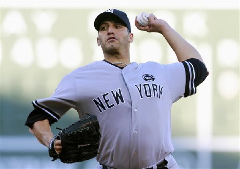 New York Yankees' Andy Pettitte pitches in the first inning of the first game of a baseball doubleheader against the Boston Red Sox, Saturday, Oct. 2, 2010, in Boston. (AP Photo/Michael Dwyer)