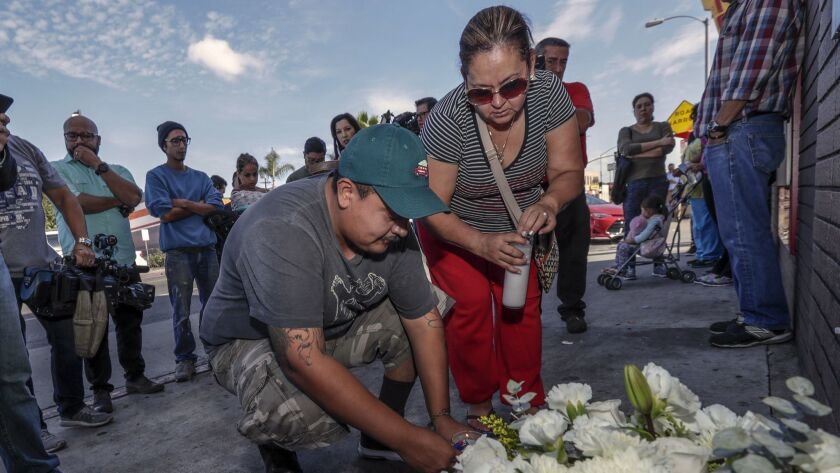 Luis Hernandez, left, and Araceli Cortez mourn the deaths of Jose Hernandez, 7, and Marcos Hernandez, 9, at a makeshift memorial on Indiana Street and Whittier Boulevard in Boyle Heights in November.