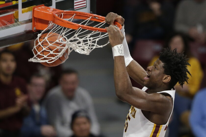 Minnesota center Daniel Orturu dunks against Clemson in the first half during an NCAA basketball game Monday, Dec. 2, 2019, in Minneapolis. (AP Photo/Andy Clayton-King)