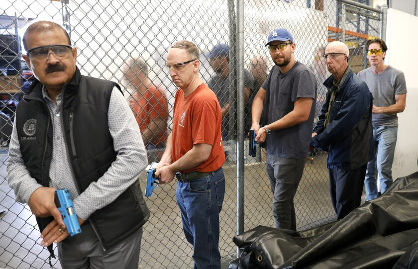 Regular folks simulate drug busts and stakeouts with the Homeland Security Investigations citizens academy. Ted Cooper, second from right, was among participants in a late October session.
