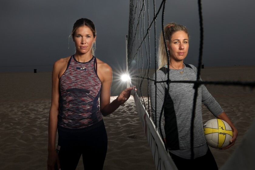 Alix Klineman, left, and April Ross are photographed before practice in Hermosa Beach in preparation for the AVP Manhattan Beach Open on Tuesday.