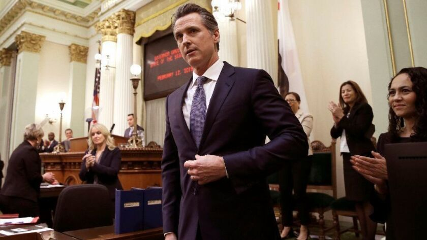 Gov. Gavin Newsom receives applause after his first State of the State address Tuesday in Sacramento.